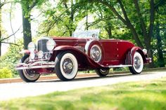 1931 Duesenberg Model SJ Disappearing Top Convertible Coupe.
