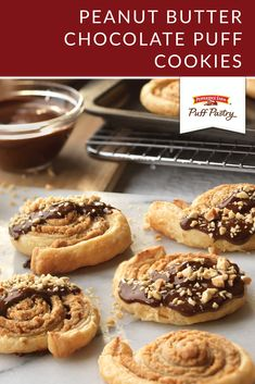 Try something new with these light and flaky Peanut Butter Chocolate Puff Cookies. Using Puff Pastry ensures a perfectly delicious cookie every time. A mixture of cream cheese, peanut butter, sugar, and vanilla is rolled up in a Puff Pastry sheet. Once they bake, these cookies get dipped in melted chocolate and sprinkled with chopped peanuts. Don't forget to remind your guests to save a few cookies for Santa!
