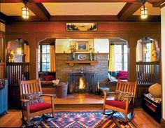 Set off by a spindled colonnade, this brick fireplace is surrounded by a generously sized inglenook with cushioned benches. Photo: Douglas Keister