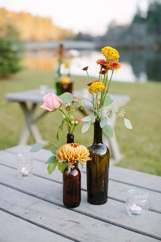 Fall florals in vintage botttle #centerpieces   Photography: http://theredflystudio.com   Floral Design: www.twigsleavesflowers.com