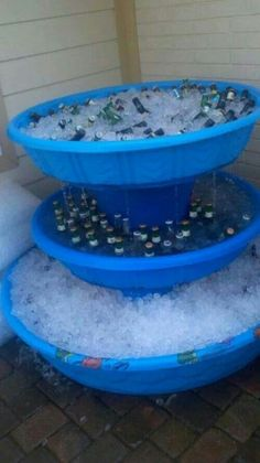 Leave out the ice and drink containers--just use water with blue food coloring, lily pads made from dollar tree ice packs and tinsel-like streamers to make a spring. Place in the center of blue tarp and surround tarp with blue pool noodles to create sittable water area for kids to pretend they are in a spring.