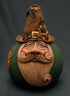 """Sunflower Garden Gnome  He is """"one of a kind"""" and handcrafted from a kettle gourd, painted with acrylic paints and handsculpted with polymer clay.  Bev's Hand Crafted Gourds"""