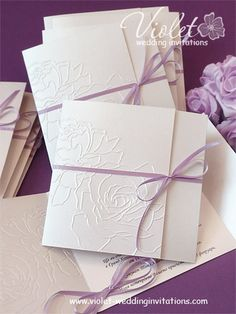 Wedding invitations with 2 embossed roses