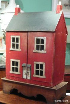 A late 19th century Doll`s house, with its` original painted finish.