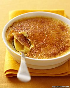 Coffee Creme Brulee - Martha Stewart Recipes-1 quart heavy cream  1 1/2 cups dark Italian-roast coffee beans  10 large egg yolks  2/3 cup granulated sugar  1/4 teaspoon salt  Boiling water, for roasting pan  5 tablespoons superfine sugar