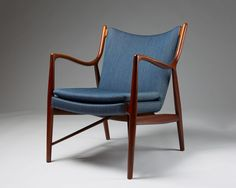 Teak, leather and wool upholsery. H: 83 cm/ 32 1/2'' D: 70 cm/ 27 1/2'' W: 77 cm/ 30 1/2'' Seat height: 43 cm/ 17'' Provenance: Dr. N. A. Sehested, Aarhus, Denmark, who purchased the chair in the early 1950's.