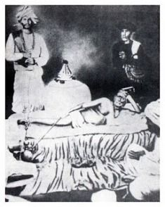 Original photo: Swami Samarth laying on Vyagrarjin (tiger skin); Cholappa Maharaj and another devotee are standing by (1870-1875)
