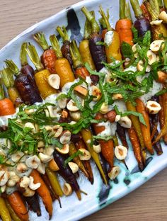 Carrots are roasted and then topped with a delicious tahini and lemon sauce, hazelnuts and chopped mint. pot recipes easy chicken whole Roasted Carrots w/ Mint & Tahini Sauce Vegetable Dishes, Vegetable Recipes, Chicken Recipes, Vegetarian Recipes, Healthy Recipes, Mint Recipes, Kale Recipes, Baked Chicken, Fudge Recipes