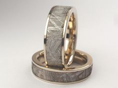 14ct white gold rings with meteorite inlays by Johan Rust.    Yes, these have meteorites in them.