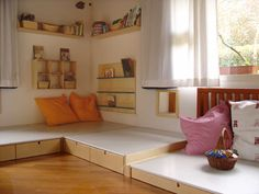 Infant room...gorgeous nido space...interesting step up idea to think about...maybe carpeted...and no adult high shelves at least in sight...this is their space...littleorchardmontessorischool.com