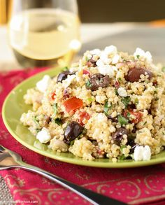 A quinoa salad filled with red onions, tomato, Kalamata olives, feta cheese and cilantro.