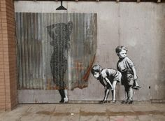 banksy graffiti  Woman showering  A woman appeares to shower behind a curtain of corrugated iron as two young children look on, in a piece that recalls some of Banksy's well-known graffiti artworks