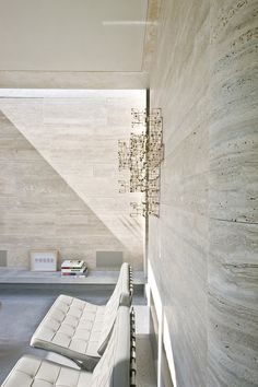 Love the way the carved stone (travertine?) looks on the curved corner. Great texture! House IV by De Bever Architecten