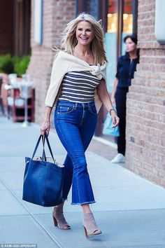 Flare for fashion: The famous swimsuit model embraced the current seventies trend by slipping her lithe legs into cropped, flared jeans that boasted a frayed hem