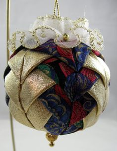 for sale on etsy. This quilted ornament was created with small pieces of fabric precisely folded to give crisp points. The order of placement determines the final