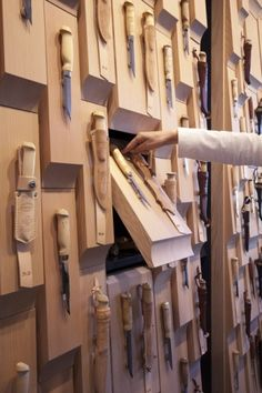 Leather-bound blades displayed against chunky wooden blocks adorn the walls of a Finnish knife shop in Helsinki by designers Suunnittelutoimisto Amerikka Exposition Interactive, Interactive Exhibition, Interactive Walls, Exhibition Ideas, Exhibition Space, Display Design, Store Design, Display Wall, Shoe Display