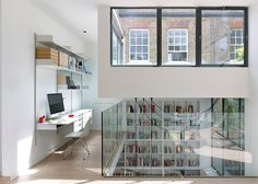 Glass walls and simple furnishings are paired with pale surfaces to give this Bloomsbury renovation by London studio Stiff + Trevillion a minimal aesthetic.