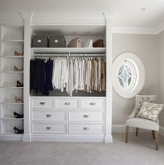light and bright closet with shelves, drawers and open hanging storage Coastal Hideaway – Sandbanks - Hayburn & Co