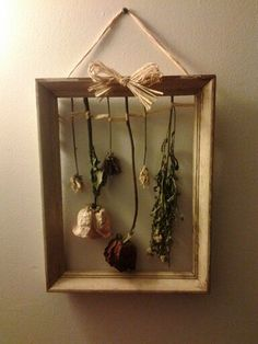 Goodwill picture frame...my daughter dried flowers from her Grandmothers funeral and hung them after they dried in this frame. So sweet and pretty.