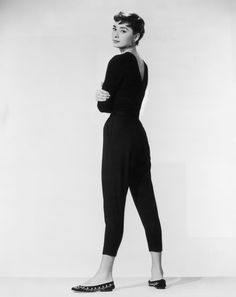 """One of Audrey's most iconic ensembles is all black—a fitted top, slim Capri pants and simple flats. It's a comfortable, fuss-free look that's still super chic and très French. In this promotional photo for Billy Wilder's 1954 film """"Sabrina,"""" Audrey looks effortlessly cool."""