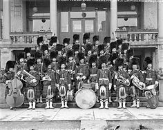 Brass band of the 72nd regiment of the Seaforth Highlanders assembled on steps of the Elysium Hotel on Pender Street, approx 1913 (the hotel was demolished in the 1970s, and replaced by an office tower at 1130 West Pender Street).