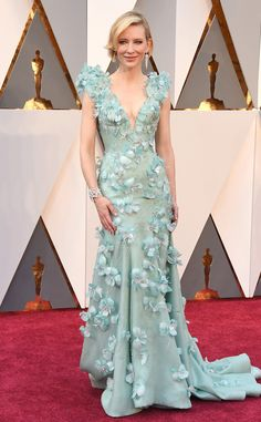 2016 Oscars; Cate Blanchett is ready for spring in a pastel blue Armani gown with a deep v neckline and floral appliques. This gown is exquisite. This gown is perfect for Cate! I love pastels especially this pastel blue color. The color is wonderful against her skin tone too.