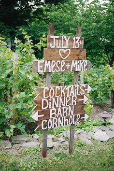 A wooden sign outside of the reception area points guests in the right direction.