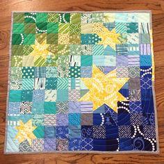 Mini quilt for the #schnitzelandboominiquiltswap by jennyrach, via Flickr.  Random wonky stars, blue - green patchwork, bound in Essex yarn dyed linen in Steel.  Spiral quilting.