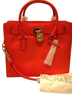 Michael Kors Nwt! Hamilton Large Leather Clementine Orange Tote Bag. Get one of the hottest styles of the season! The Michael Kors Nwt! Hamilton Large Leather Clementine Orange Tote Bag is a top 10 member favorite on Tradesy. Save on yours before they're sold out! GORGEOUS!!! ON SALE NOW FOR A LIMITED TIME!!! WOW!!!