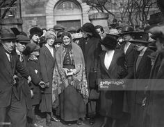 Political activist Maud Gonne (1865 - 1953) comforts Mrs Wheelan after the killing of political prisoners in Dublin.