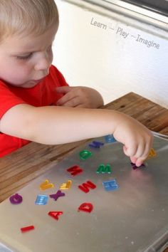 How to make a sticky alphabet tray for learning letters through sensory play.