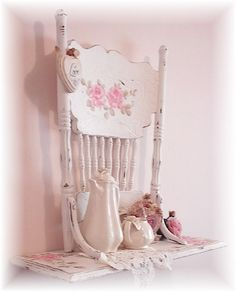 How cute!  Great idea if you have a detailed chair and not enough floor space to set it...make a shelf out of it and hang it up!