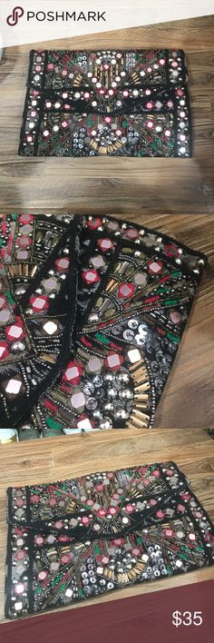 ZARA Ethnic Design Envelope Clutch Beautifully designed clutch with embroidery, sequins, beading, rhinestones and mirrors on top of a tribal/ethic print. Large enough to carry essential items. Comfortably fits under arm for carrying as a clutch. Used once, and in excellent condition. Come with Zara dustbag. Zara Bags Clutches & Wristlets