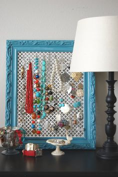 DIY Jewelry display using radiator grill.  Organization makes everything, including getting ready, run smoother.