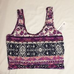 NWT pacsun purple crop top NWT Pacsun purple Aztec like crop top with pink, white, and plum. Size small.  Never worn and in great condition. Ask for try on pics or bundles. PacSun Tops Crop Tops