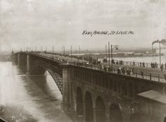 Pedestrians viewing the Mississippi River from the Eads Bridge during the 1903 flood. Missouri History Museum