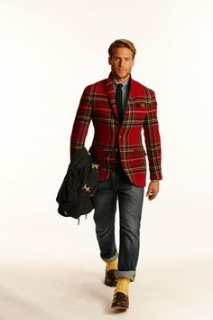 Shop this look for $332:  http://lookastic.com/men/looks/blazer-and-tie-and-dress-shirt-and-jeans-and-socks-and-loafers/1721  — Red Plaid Blazer  — Black Tie  — Grey Dress Shirt  — Charcoal Jeans  — Yellow Socks  — Brown Leather Loafers
