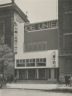 View of Cafe de Unie in Rotterdam, designed by the architect J.J.P Oud. Several groups stand at sides of image looking towards the photograp...