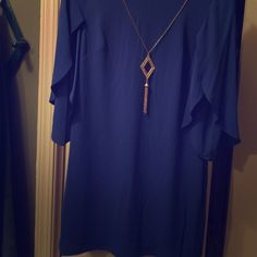 Blue dress Mini...Blue dress I'm a size 10 and it fits me like a shirt...definitely  small size...more a Size 4...really 3/4 flutter sleeves...bought secondhand and never wore,so selling for what I bought it for AD Studio Dresses Mini
