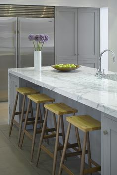 Roundhouse marble worktop and Pinch stools nice and clean and cool for tropical climates