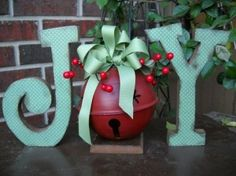 christmas diy ....modge podge, scrap book paper, wood letters, jingle bell, holly, ribbon and wood base....easy:)