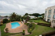 WALK TO THE BEACH Lovely apartment with communal entertainment area, braai area and garden. Fully furnished on floor with sea views.
