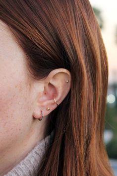 Le Fashion Blog Multiple Piercings Red Hair Ariel Gordon Huggie Mini Helix Stud Jewelsmith Small Thin Orbital Hoop Model Libby Strachan Tan Turtleneck