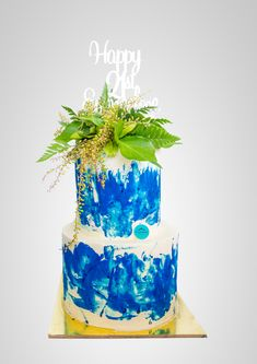 Birthday Cake by Passiontree Velvet 2 Tier cake aqua colour with green leafs topping.