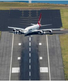 A Qantas Airbus A380 on the runway waiting for clearance to takeoff ...