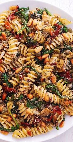 Italian Pasta with Pine Nuts, Spinach, Artichokes, Capers, Garlic, and Sun-Dried Tomatoes #pasta #meatlesspasta #bestpasta #easypasta #spiralpasta #spinachpasta #pinenutpasta