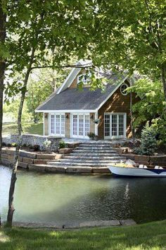 Lakeside lakefront cottage with wooden shaker siding and white trim. Lots of french doors that open out to the back deck porch and the lake. Steps down to the lake and boat dock. Cozy lake cottage home. Home design decor inspiration ideas. Lakeside Cottage, Lake Cottage, Cozy Cottage, Cottage Style, Waterfront Cottage, Nantucket Cottage, Lakeside Living, River Cottage, Waterfront Homes