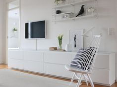 Muurame modules.  Finland.  Sold by Domus, Atlanta.  All white, all birch, or birch fronts on white.