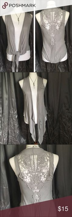 """Gray sleeveless tank top/ tunic, crochet Unbranded grey lightweight sleeveless tank/tunic •Can be worn as-is or tied in the front or to the side.  •Has crochet detail in the back.   •Really cute!!  •Fabric is lightweight and really soft.   •No visible wear-good condition!   •Size Sm •length in back: 23"""", length in front (if let hang): 35"""", armpit to armpit: 17""""  🎀 Check out more tanks in my closet 🎀 ⚜️ Same/next day ship ⚜️ 🐲Smoke-free 🐲  I do not discuss price in the comments Tops Tank…"""