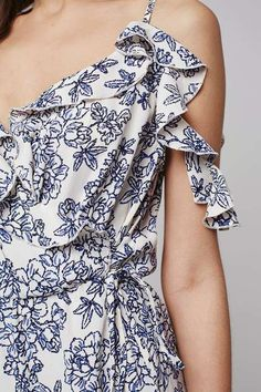 All-over floral print cold shoulder wrap dress with self-tie and ruffled v-neckline. #Topshop